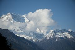 Clouds over the snowcapped mountains, Himalayas, Uttarakhand, In Stock Photography