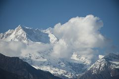 Clouds over the snowcapped mountains, Himalayas, Uttarakhand, In. Clouds over the snowcapped mountain range, Himalayas, Uttarakhand, India Stock Photography