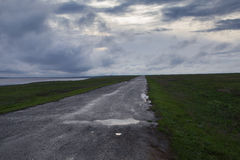 Clouds over the steppe. Stock Images