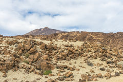 Clouds over a stone desert. Cumulus clouds filled the morning skies over the rocky desert at the foot of the volcano Teide on Tenerife Royalty Free Stock Image