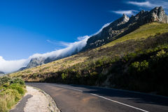 Clouds over the Table Mountain. Clouds are flowing over the Table mountain above the Cape Town, South African Republic stock photo