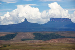 Clouds over tepui. White clouds in blue sky over table-top mountains called Tepui in Gran Sabana, Guayana Highlands, Venezuela, South America. Events of novel of Royalty Free Stock Photo