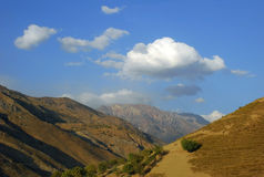 Clouds over the Tien Shan in the fall Royalty Free Stock Images