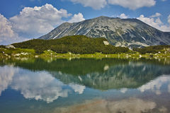 Clouds over Todorka Peak and reflection in Muratovo lake, Pirin Mountain Stock Images