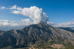 Clouds over top of Sierra de Bernia mountains range, near Benido Stock Photography