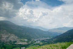 Clouds over the town of Sort in Pyrenees Spain stock photos