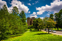 Clouds over trees and a building at Druid Hill Park, in Baltimor Royalty Free Stock Photo