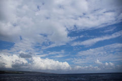 Clouds over the tropical ocean Stock Images