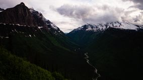 Clouds over a valley in glacier national park. Timelapse of clouds rolling over a valley from the going to the sun road in glacier national park in montana stock video