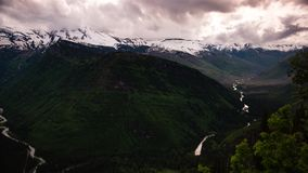 Clouds over a valley in glacier national park stock footage