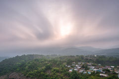 Clouds over a village in the hills. Morning clouds swishing over a village in BR Hills, Karnataka royalty free stock photo