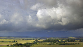 Clouds over the village. Village before the storm weather Royalty Free Stock Photo