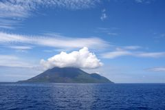Free Clouds Over Volcanic Island Royalty Free Stock Photo - 1051935