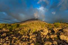 Clouds over the volcanic mountain Royalty Free Stock Image