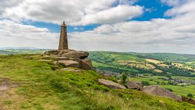 Wainman`s Pinnacle, North Yorkshire, England, UK. Clouds over Wainman`s Pinnacle near Cowling, North Yorkshire, England, UK stock photography