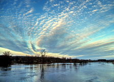 Clouds over water. Fuzzy clouds over a river Royalty Free Stock Photography