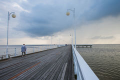 Clouds over a wooden pier Royalty Free Stock Photos