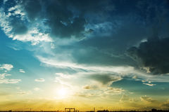 Clouds over yellow sunset Stock Photography