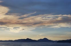 Clouds Painting. Sunset clouds painting over Manzanillo bay, Mexico Stock Photos
