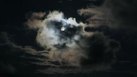 Clouds passing by moon at night in the mountains. Full moon at night with clouds real time. stock video
