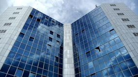 Clouds passing on window of building stock footage