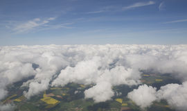Clouds from the plain view Royalty Free Stock Photo