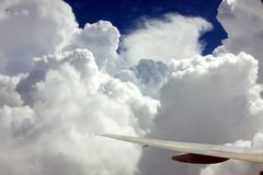 Clouds from the plane. View of the sky from the back window of the plane Stock Images
