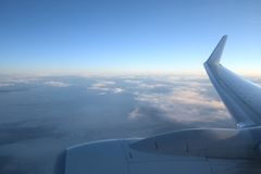 Clouds from Plane. Clouds and horizon seen from above, through a plane window. Very nice view royalty free stock photos