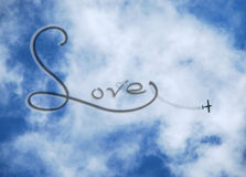 Clouds and plane in love Stock Image