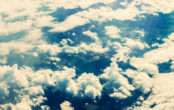 Clouds through plane window Royalty Free Stock Image