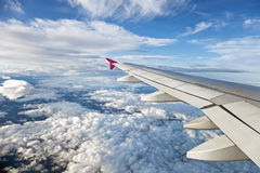 Clouds and plane wings Stock Photography