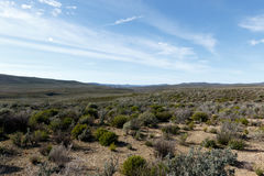 Clouds pointing to the endless wonder of Tankwa Karoo Stock Photography