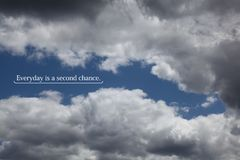 Clouds with a positive saying. Clouds in the sky with a saying that says Everyday is a second chance Stock Photography