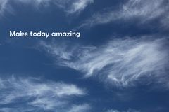 Clouds with a positive saying. Clouds in the sky with a saying that says to make today amazing Stock Photo