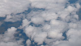Clouds puffy fluffy sky aerial plane drone view on land earth ground stock footage