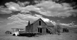 Clouds Racing. Abandoned house shot in infrared Stock Image