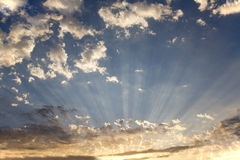 Clouds with radiating crepuscular sun rays. Crepuscular sun rays radiating through clouds Stock Photo