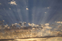 Clouds with radiating crepuscular sun rays. Crepuscular sun rays radiating through clouds Stock Photography