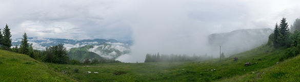 Clouds and rain in a mountain valley landscape panorama Stock Photo