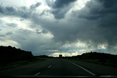 Clouds and rain over a highway in the state of utah, USA. royalty free stock photos