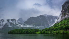 Clouds and rain over mountain lake in Hallstatt Stock Photo