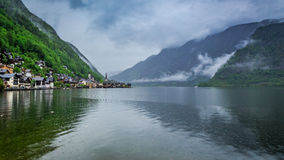 Clouds and rain under mountain lake in Hallstatt Royalty Free Stock Photos