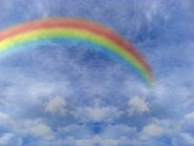 Clouds and rainbow. Symbol of peace and hope: a wonderful rainbow over blue cloudy sky Stock Image