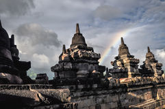 Clouds and Rainbow Buddist temple Borobudur complex in Yogjakart Royalty Free Stock Photos