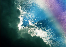 Clouds and Rainbow Colors Stock Photo