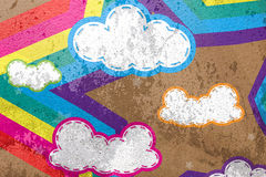 Clouds and rainbows star on cement background Royalty Free Stock Photo