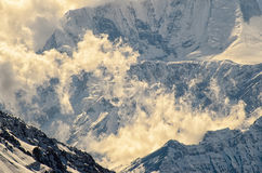 Clouds Raising in Mountains in a wonderful soft light. Mystique Clouds Raising in Mountains in a wonderful soft light Royalty Free Stock Photo