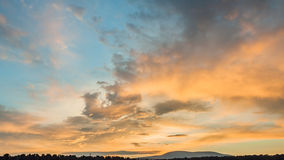 Clouds. In the rays of the rising sun on the mountain pass Royalty Free Stock Photography