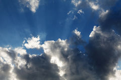 Clouds with rays of sun on a background of  sky Stock Photo