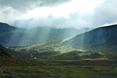 Clouds rays sun valley Scotland Royalty Free Stock Images